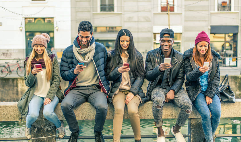 Row of people on their smartphones